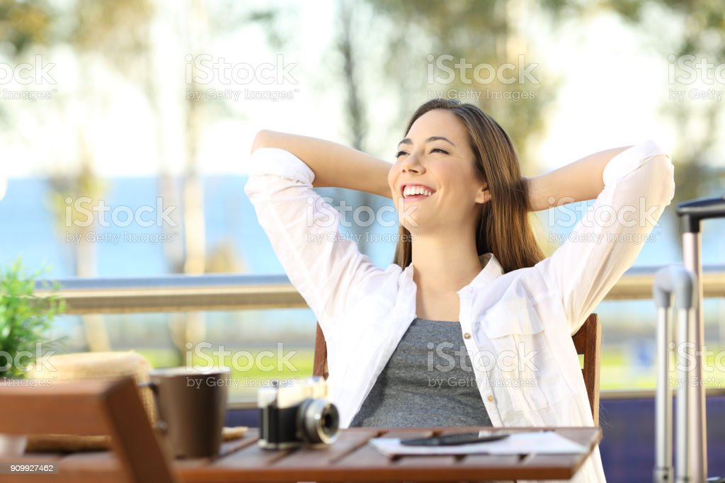 Satisfied tourist enjoying vacations at hotel stock photo
