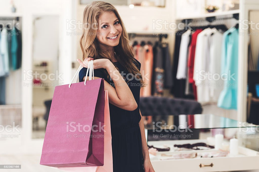 Satisfied with her shopping. stock photo
