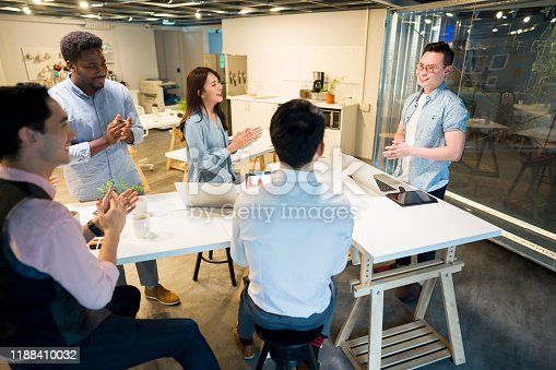 681735120istockphoto Satisfied with his presentation 1188410032