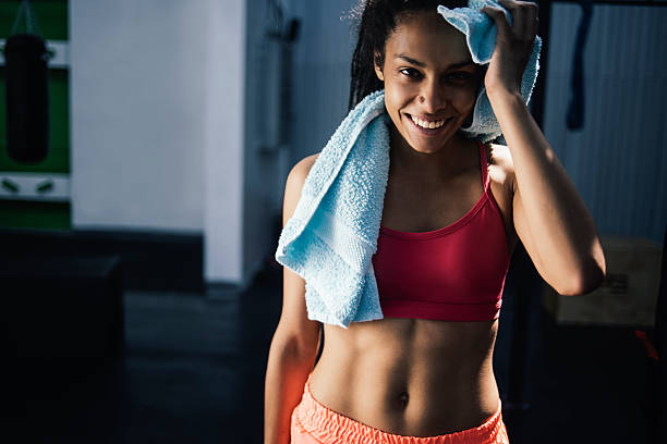 satisfied with the results - black woman towel workout bildbanksfoton och bilder