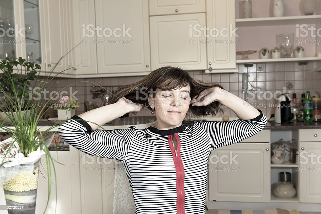 Satisfied Woman in Domestic Kitchen, Europe royalty-free stock photo