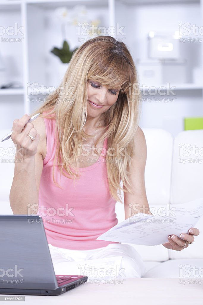 Satisfied women with bills royalty-free stock photo