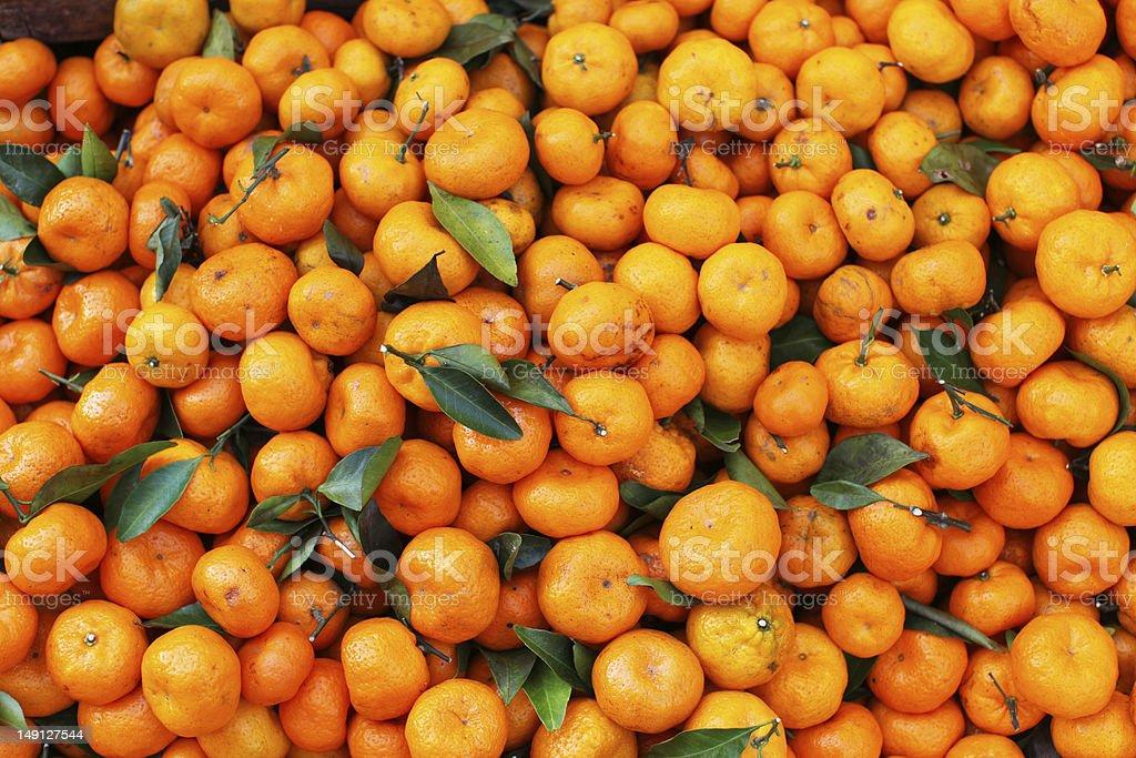 Satsuma mandarin in bulk on the market stock photo