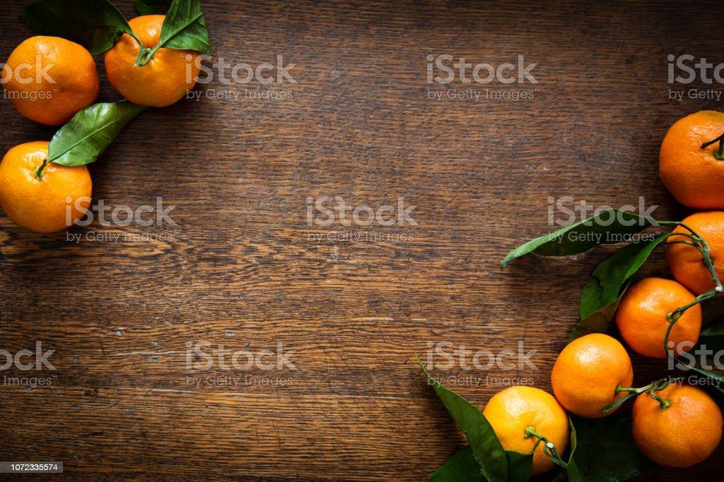Satsuma Mandarins on an Wooden Table Background stock photo