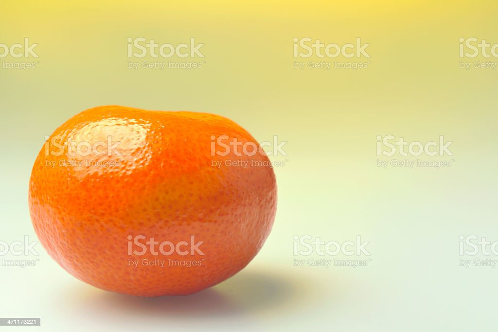satsuma on yellow background royalty-free stock photo