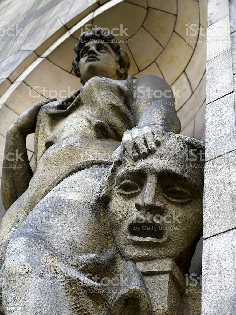 Satue of woman holding man's head royalty-free stock photo