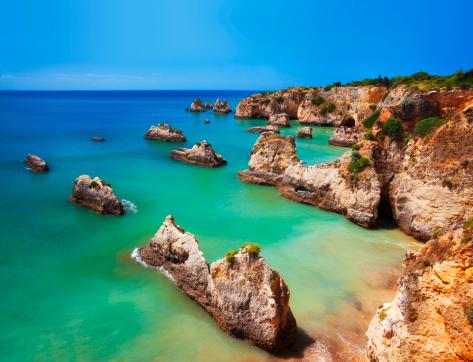 Praia Do Vau in Algarve, Portugal with huge rocks on the beach.