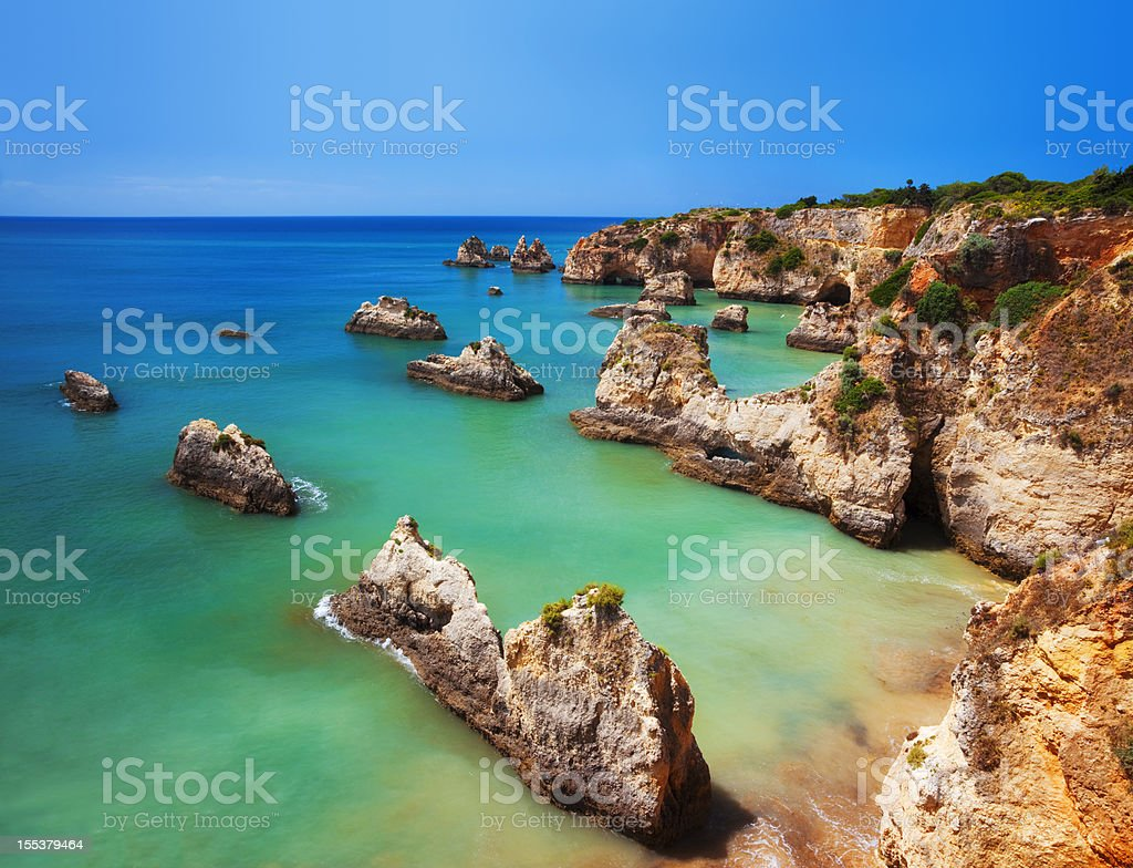 Saturated image of a colorful Algarve beach in Portugal stock photo