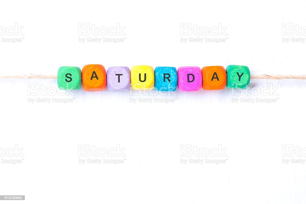 saturday word of multicolored cubes stock photo