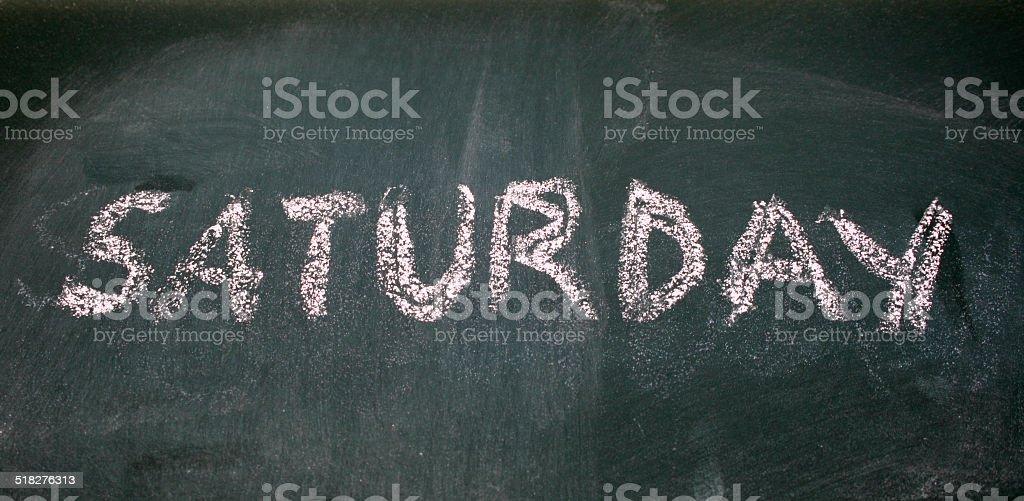 saturday written with chalk on blackboard stock photo