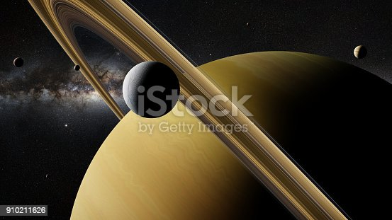 istock Saturn moon Enceladus in front of planet Saturn, rings and other moons 910211626