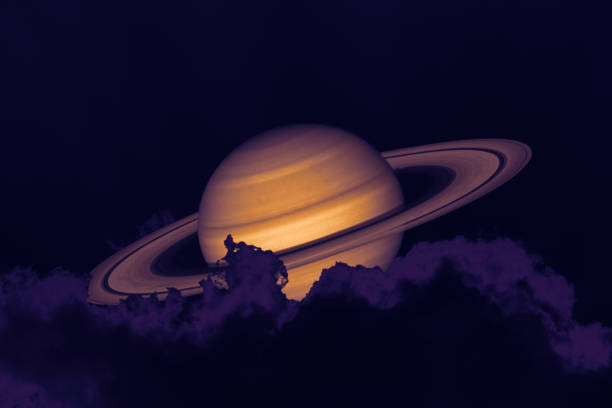 Saturn on night sky back silhouette mountain and heap cloud stock photo