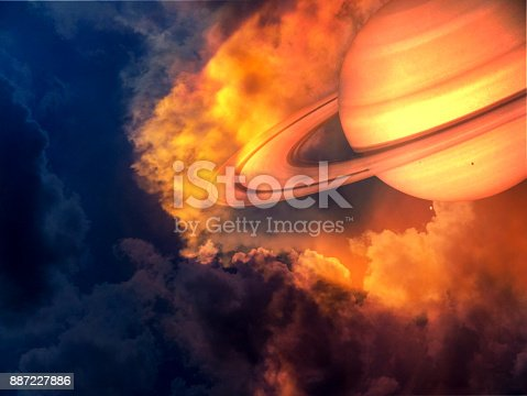istock saturn red hot and space on sunset sky 887227886