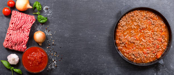 sauce bolognese and ingredients for cooking stock photo