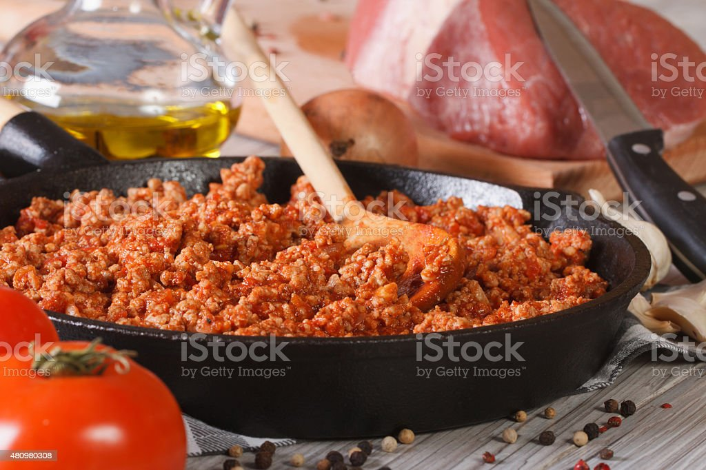 sauce Bolognese in a pan and ingredients closeup horizontal stock photo