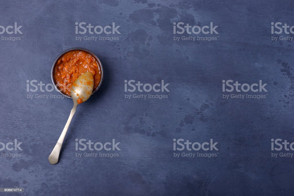 Sauce in bowl with spoon stock photo