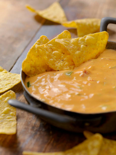 Salsa Con Queso Chili Cheese Dip dipping sauce stock pictures, royalty-free photos & images