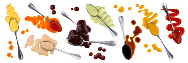 Sauce with spoon isolated on white background, collection of different spilled and flowing sauces Sauce with spoon isolated on white background with clipping path, collection of different spilled and flowing sauces salad dressing stock pictures, royalty-free photos & images