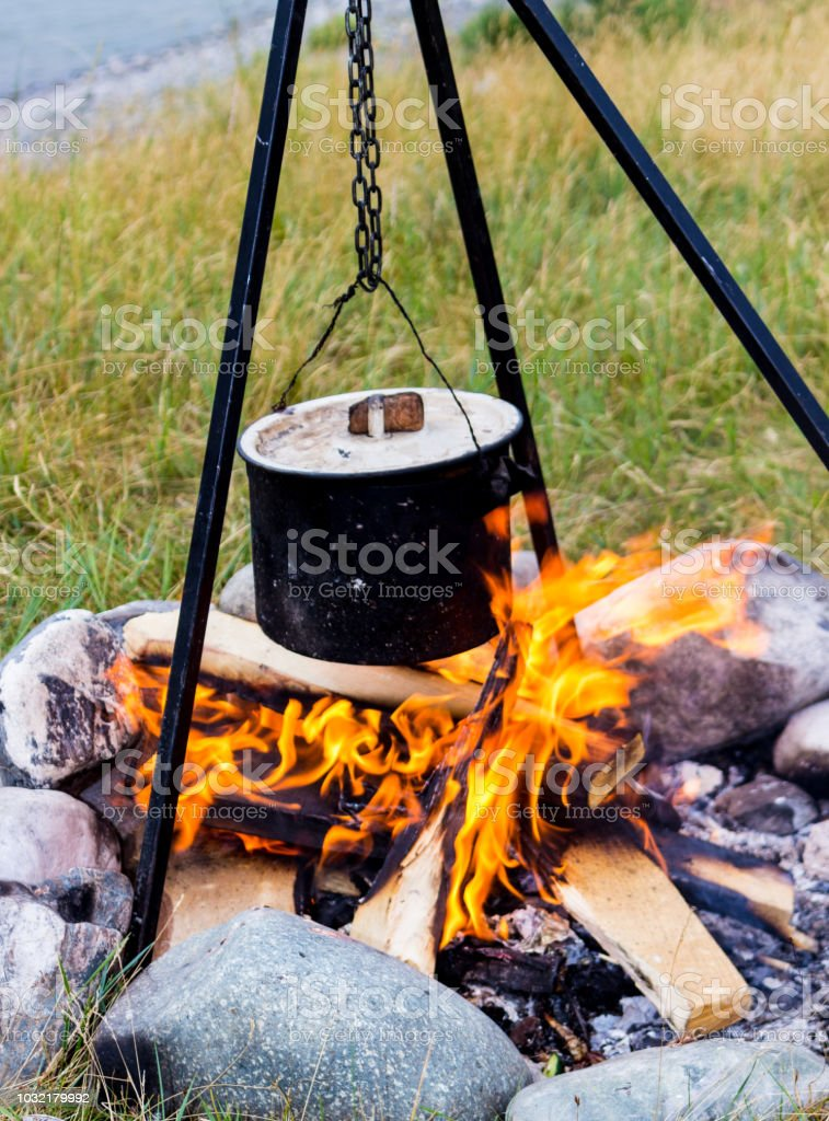 Saucepan hanging over the fire stock photo