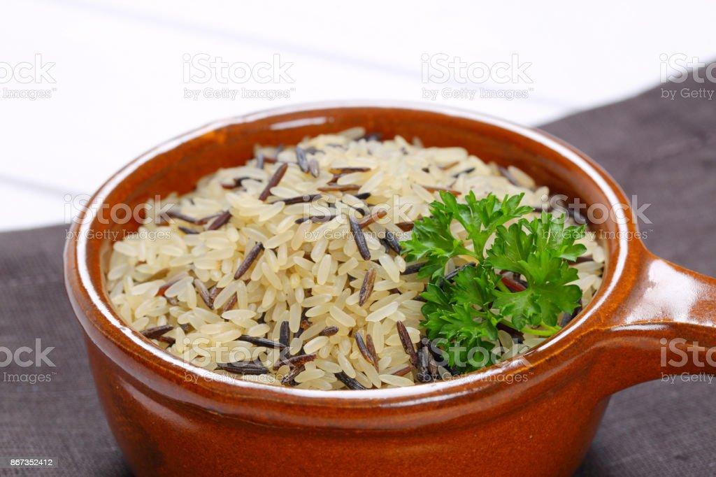 saucepan of wild rice stock photo