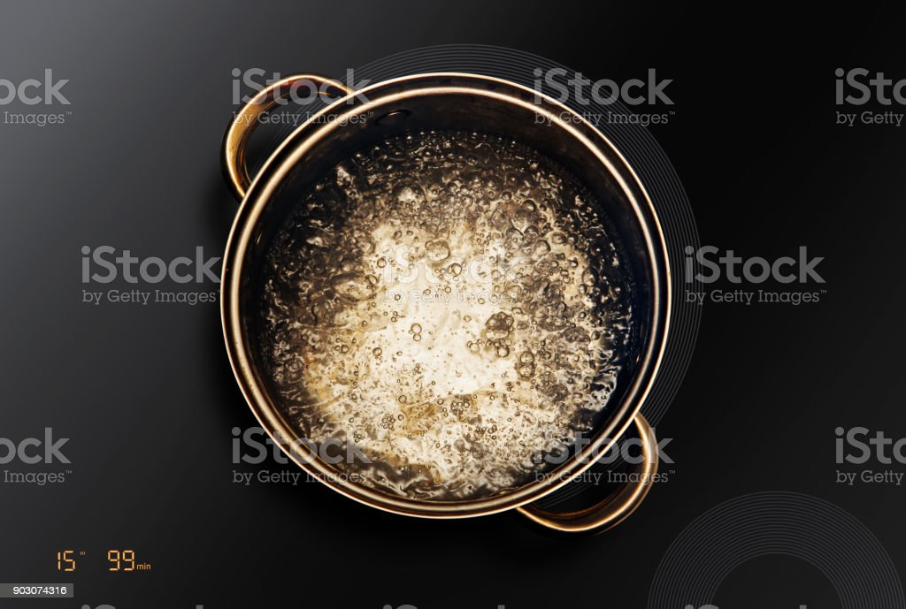 saucepan on black induction cooktop stock photo