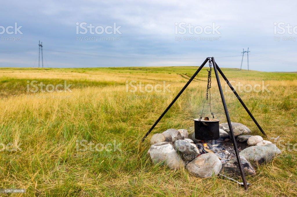 Saucepan on campfire stock photo