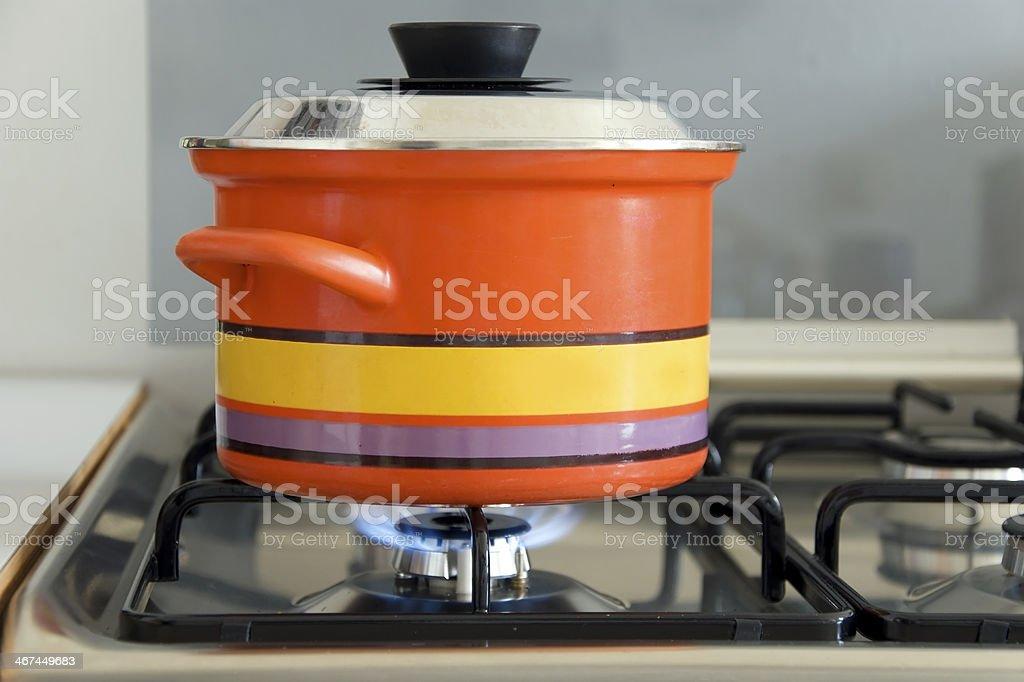 saucepan on stove stock photo