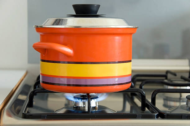 saucepan on stove stock photo