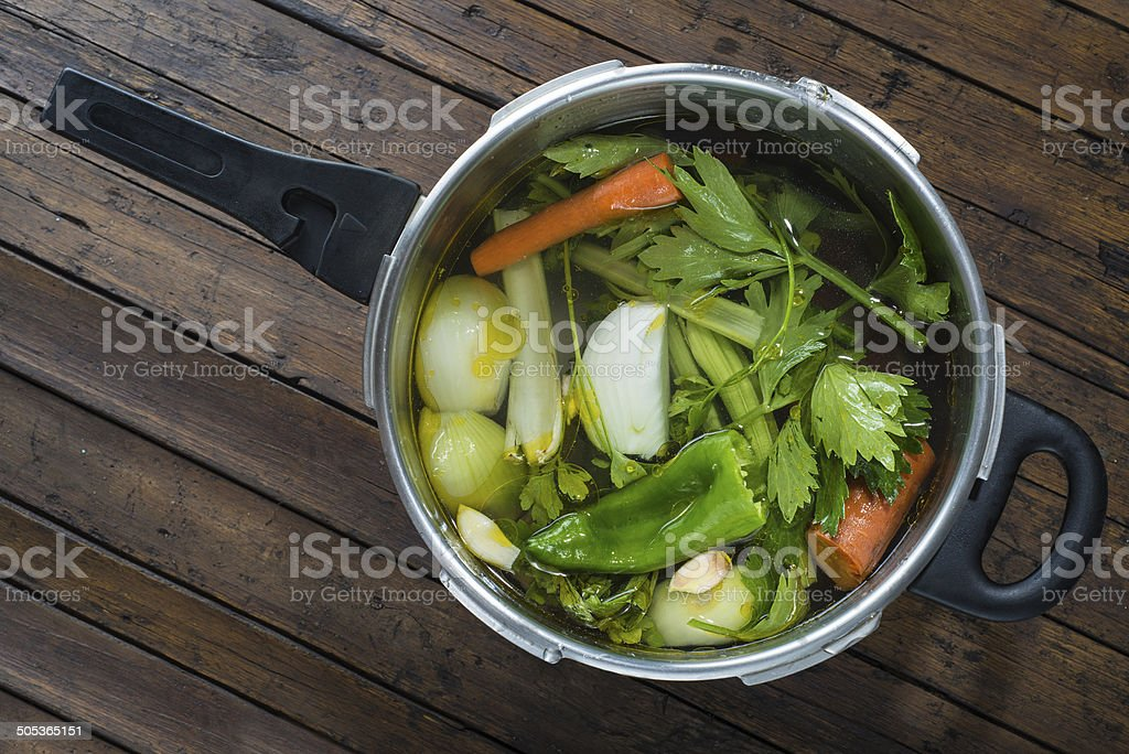 Saucepan with vegetables to cook a soup stock photo