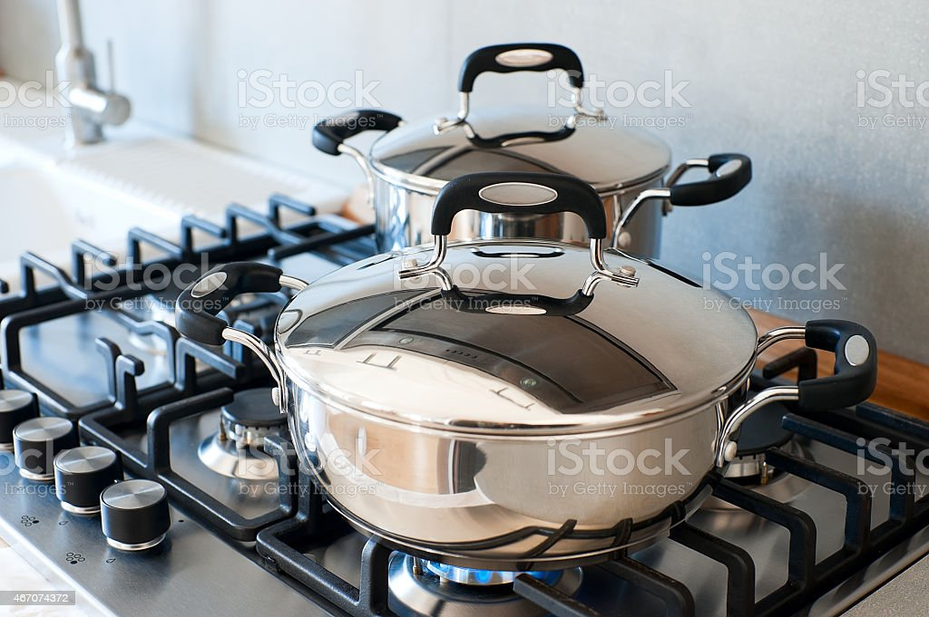 Saucepans stainless steel stock photo