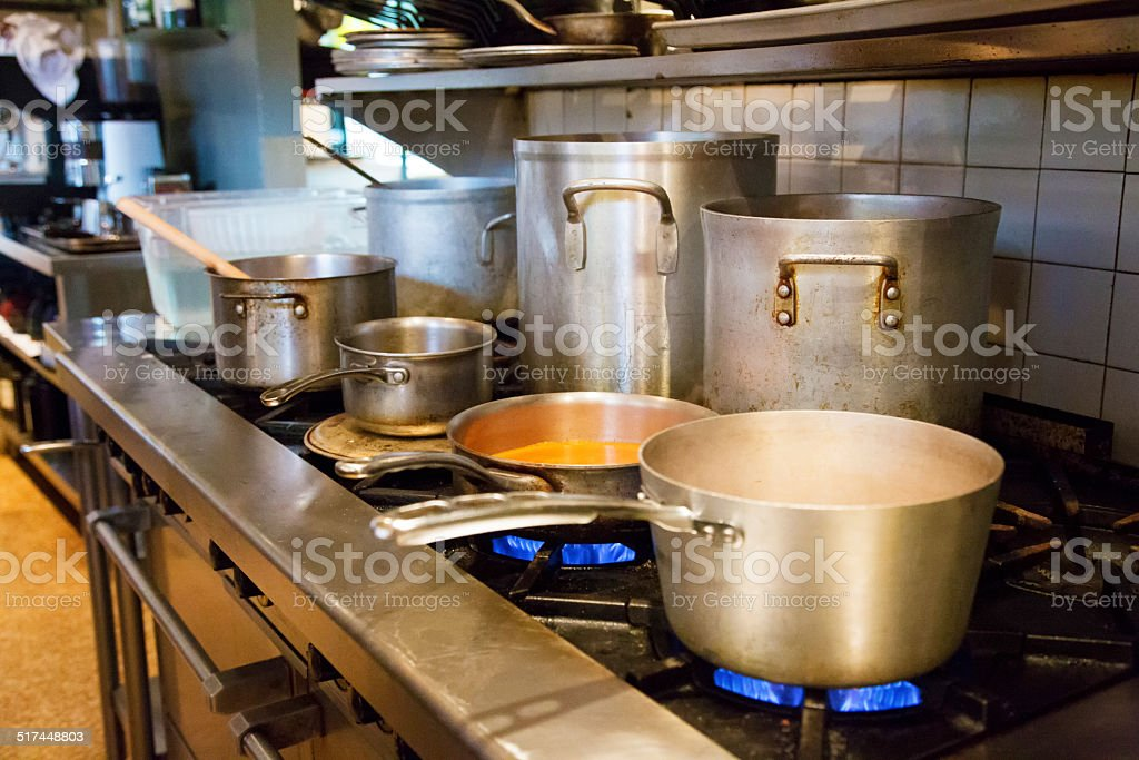 Sauces and soups simmering in restaurant kitchen stock photo