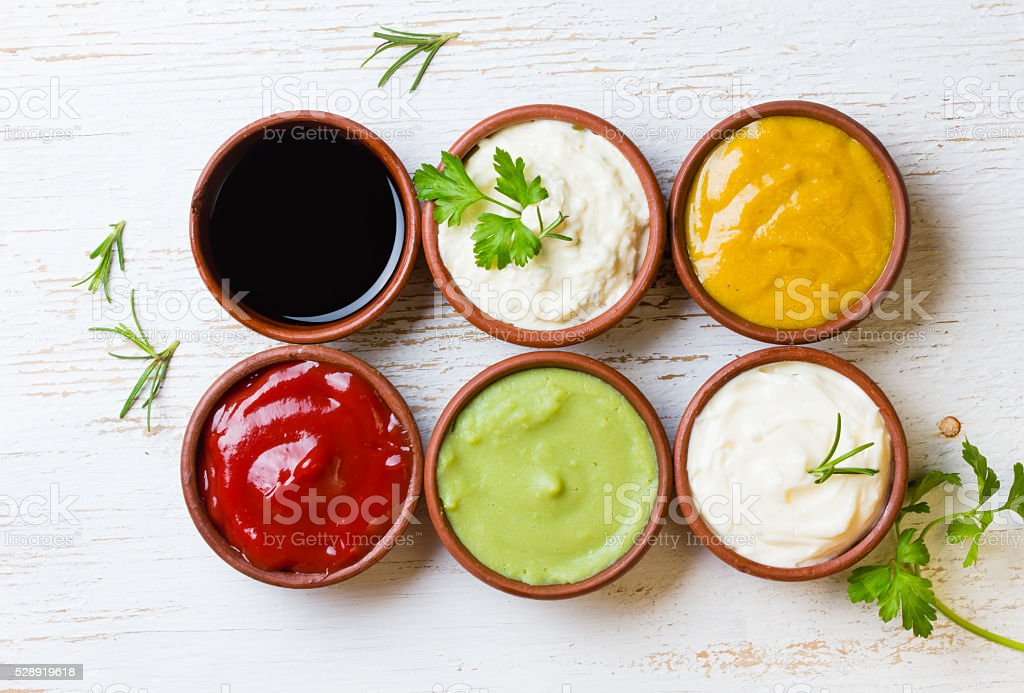 Sauces ketchup, mustar, mayonnaise, wasabi, soy sauce in clay bowls stock photo