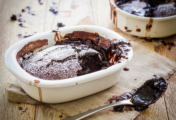 saucy chocolate pudding - chocolate mousse stock photos and pictures