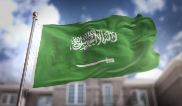 saudi arabia flag 3d rendering on blue sky building background - saudi national day zdjęcia i obrazy z banku zdjęć