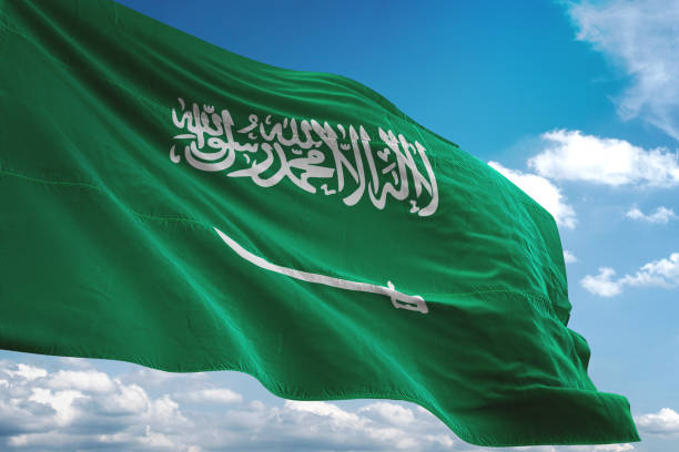 Saudi Arabia flag waving cloudy sky background Saudi Arabia flag waving cloudy sky background realistic 3d illustration saudi arabia stock pictures, royalty-free photos & images