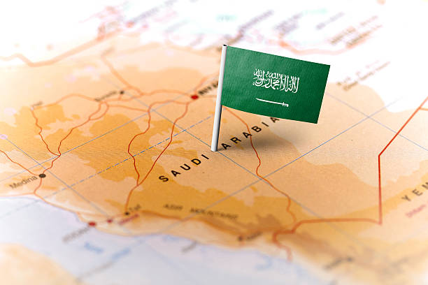 saudi arabia pinned on the map with flag - saudi arabia map stock photos and pictures