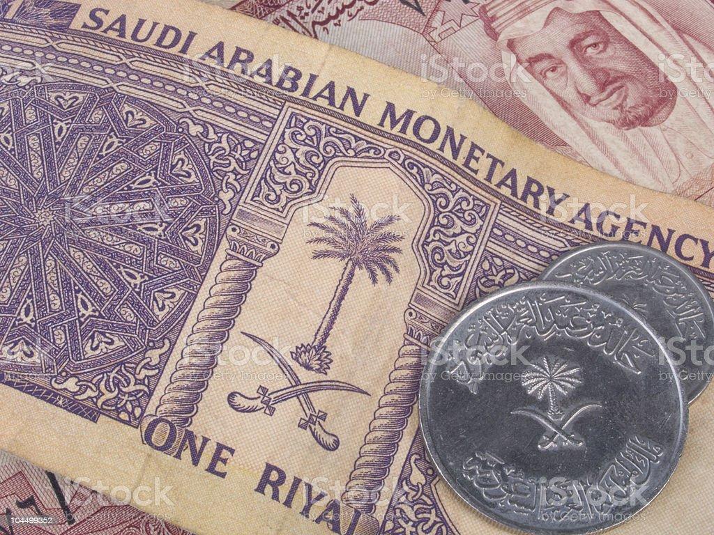 Saudi Arabian banknotes and coins stock photo