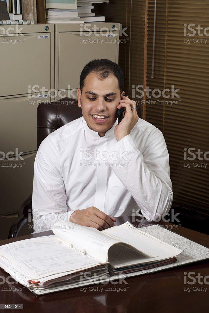 Saudi Arabian Business Man Talking Over Phone in Office royalty-free stock photo