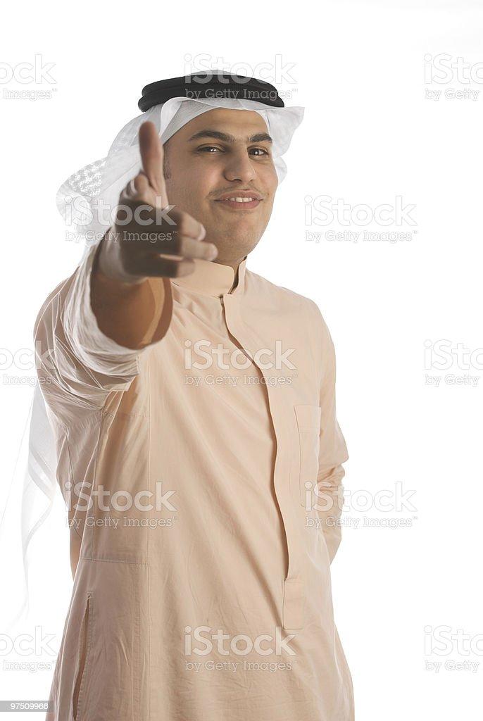 Saudi Arabian businessman wearing thobe and smiling royalty-free stock photo