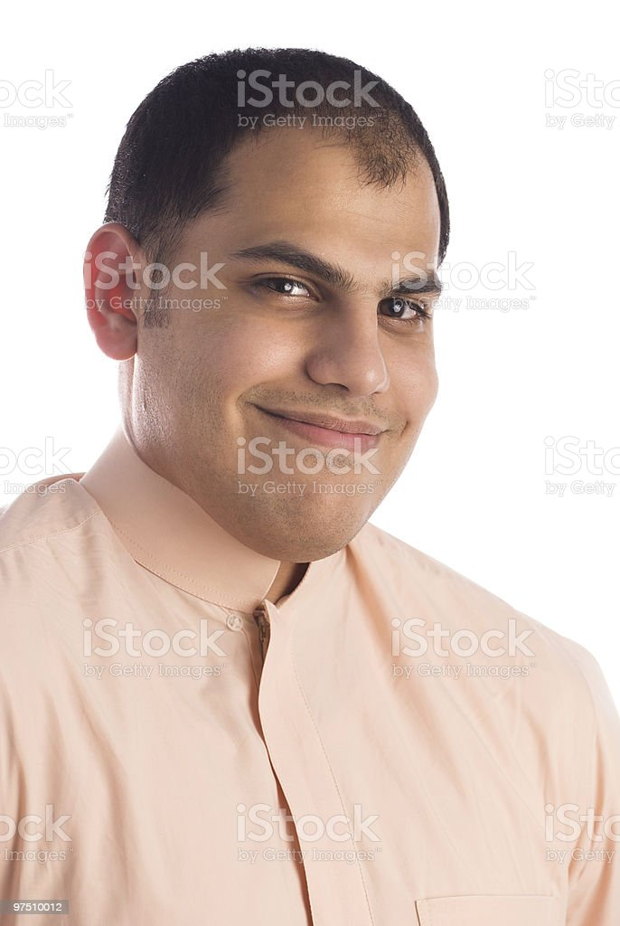 Saudi Arabian male model wearing thobe and smiling royalty-free stock photo