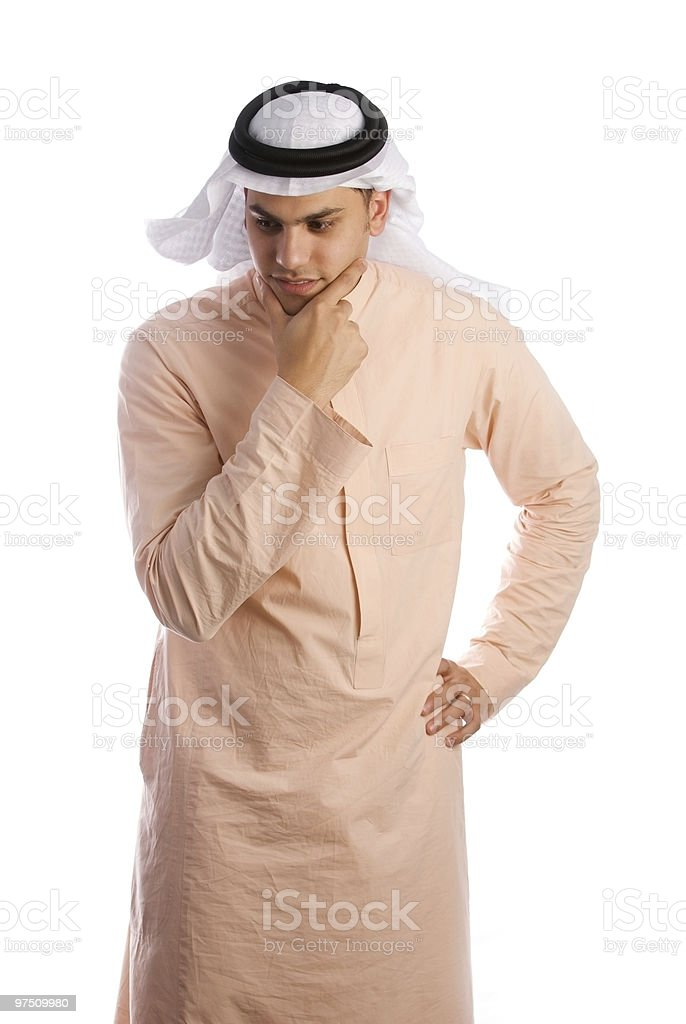 Saudi Arabian male wearing the traditional dress and thinking royalty-free stock photo