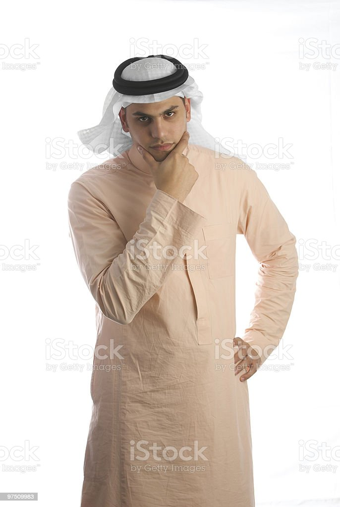 Saudi Arabian male wearing the traditional dress and thinking royalty-free stock photo