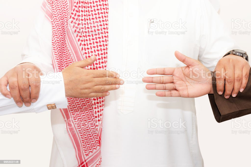 Saudi shake hands stock photo