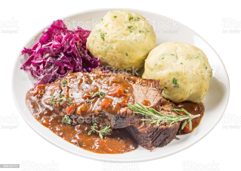 Sauerbraten on plate isolated стоковое фото