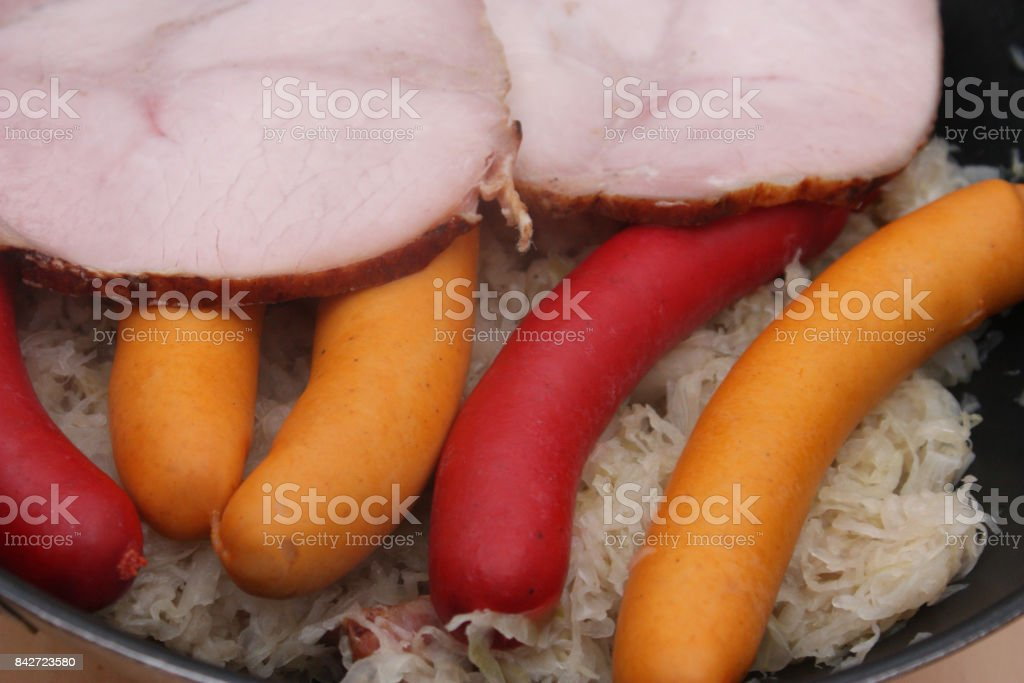 Sauerkraut garnished with sausages and ham stock photo
