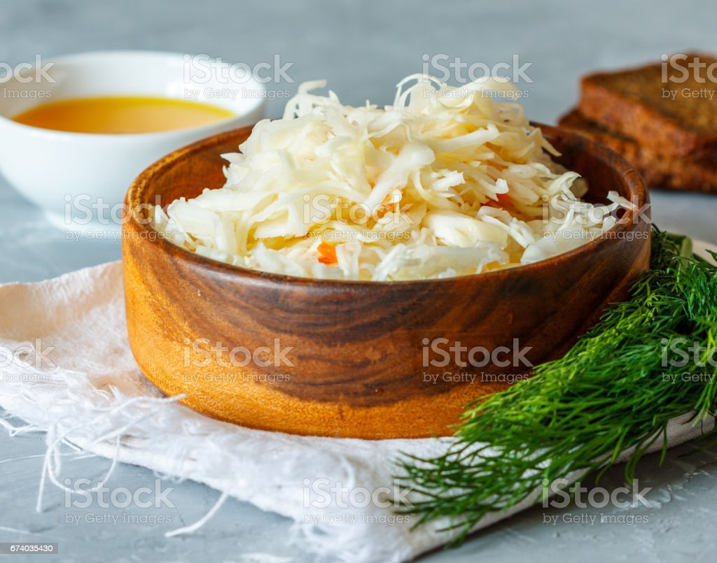 Sauerkraut in wooden bowl royalty-free stock photo