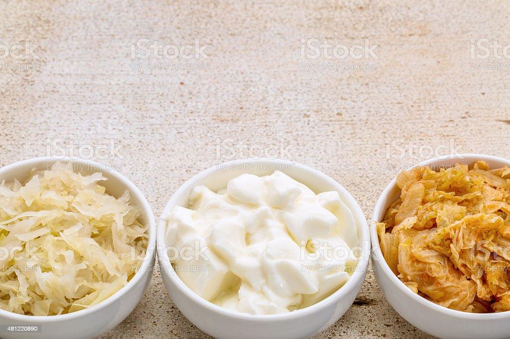 sauerkraut, kimchi and yogurt stock photo