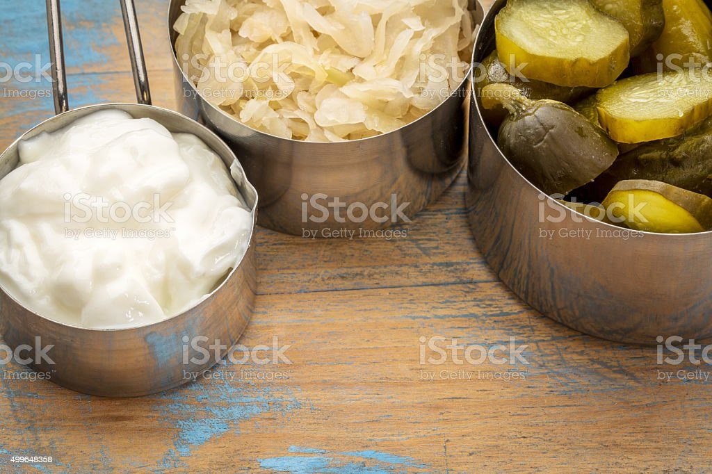 sauerkraut, pickles and yogurt stock photo