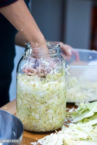 Woman making home fermented sauerkraut.