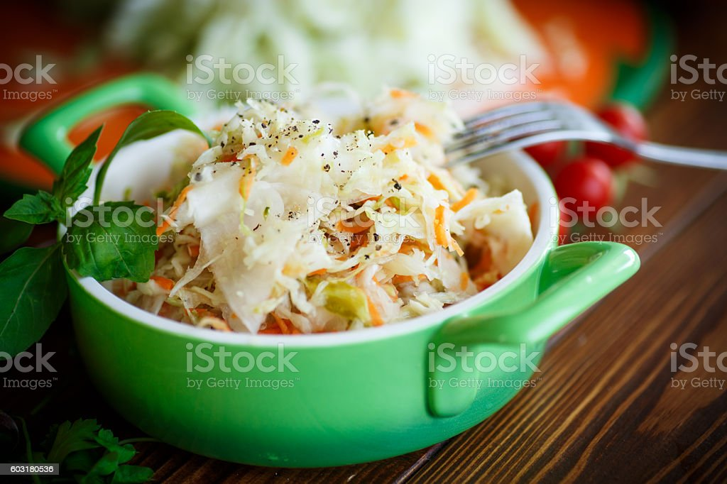Sauerkraut with carrots in a bowl stock photo